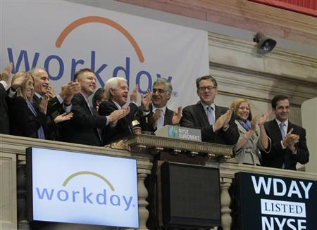 Co-CEO Aneel Bhusri (4th from left) ring the opening bell with company executives in celebration of the company's IPO at the New York Stock Exchange, October 12, 2012.