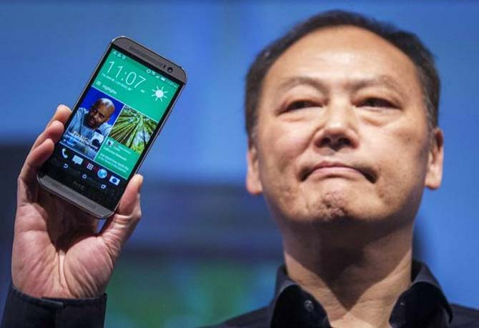 HTC CEO Peter Chou shows the new One M8 phone during a launch event in New York.