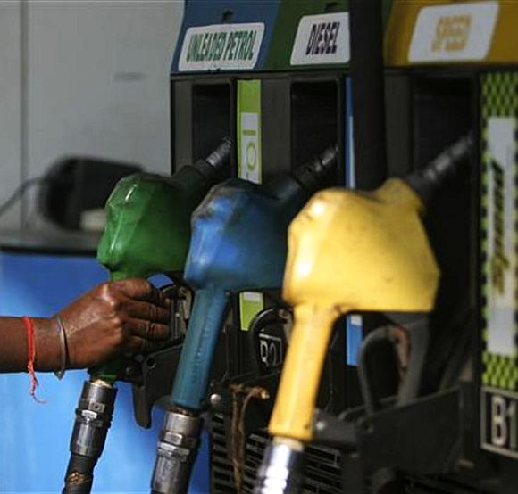 An Attendant about to fill up petrol at a pump in Mumbai.