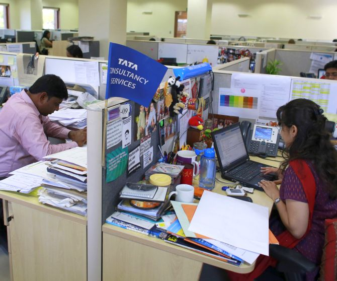Employees work at TCS office.