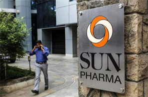 An employee speaks on phone as he walks out of research and development centre of Sun Pharmaceutical. Photograph: Danish Siddiqui/Reuters