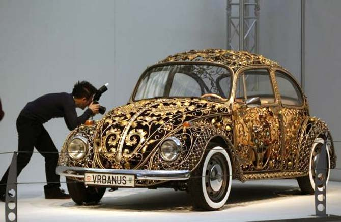 A visitor takes a picture of a modified Volkswagen Beetle during a press presentation prior to the Essen Motor Show in Essen, Germany.