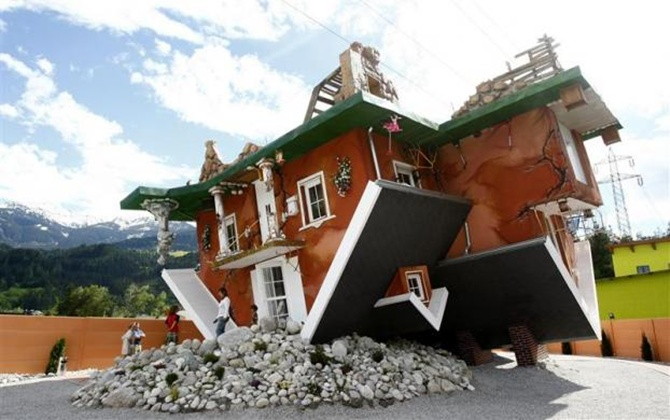 Visit two amazing upside-down houses!