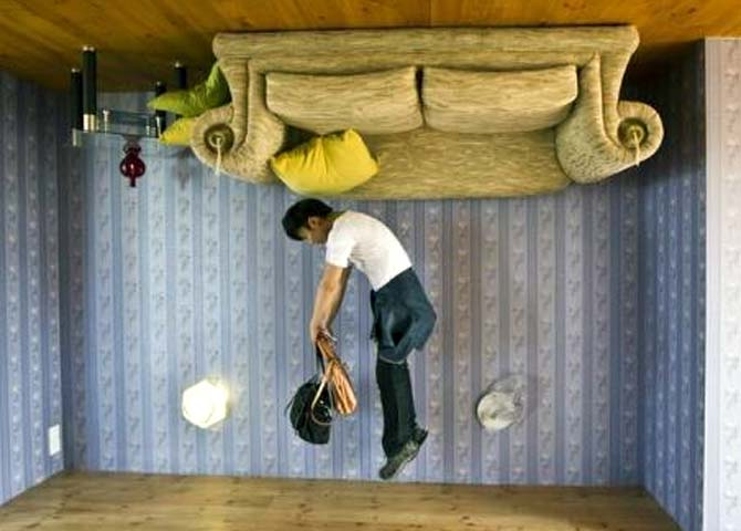 A tourist jumps inside the house.
