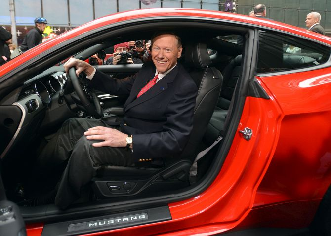 Alan Mulally, President and CEO, Ford Motor Co. in the driver's seat of the new 2013 Ford Fusion during the Charity Preview at the 2012 North American International Auto Show.