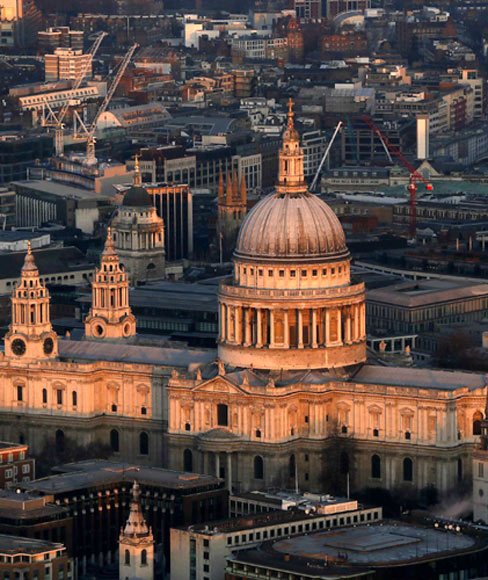St Paul's cathedral is lit by the early morning sun in an aerial view taken from The View gallery at the Shard, western Europe's tallest building, in London.