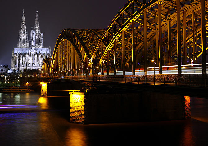 The UNESCO World Heritage Cologne Cathedral and the Hohenzollern railway bridge along the river Rhine is seen before Earth Hour.