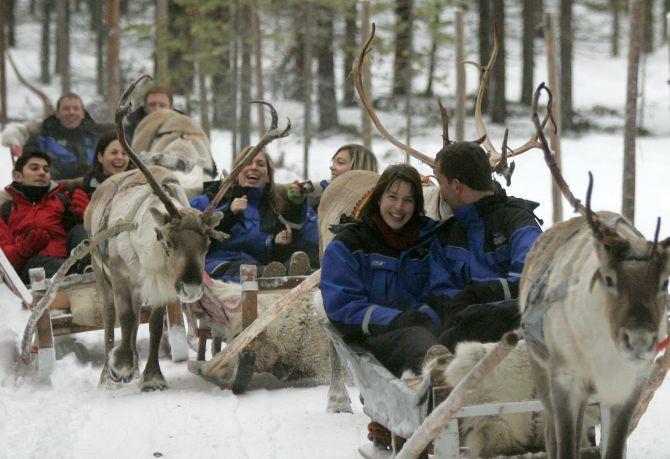 Tourists take part in the reindeer safari at Arctic Circle.