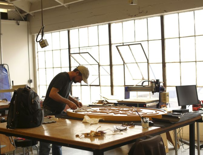 A designer works on a restaurant sign at TechShop in the South of Market neighborhood in San Francisco.