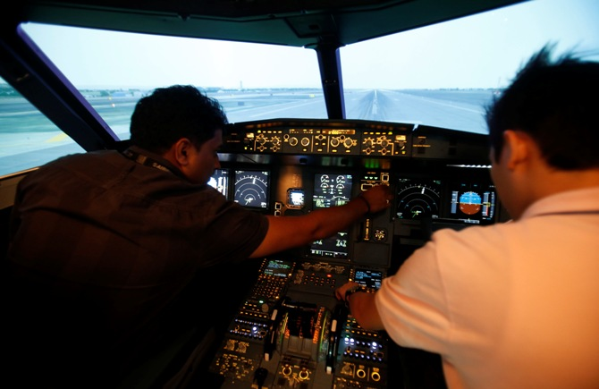 Pilots prepare before they go through their biannual review in a flight simulator
