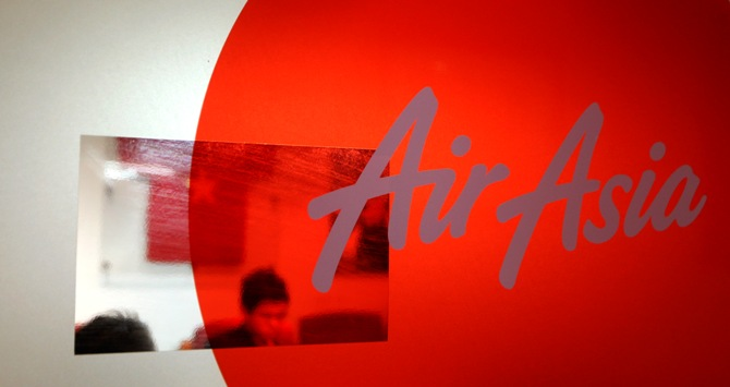 A staff of Air Asia works inside the Air Asia office in Sepang outside Kuala Lumpur.