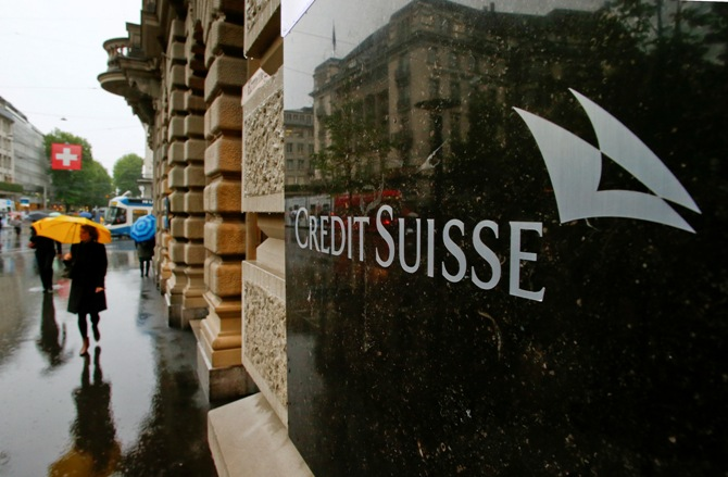 Swiss bank Credit Suisse logo is seen in front of its headquarters in Zurich May 2, 2014.