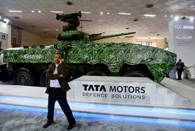A visitor speaks on his mobile phone in front of Tata Motors' Kestrel, an armoured personnel carrier, at a defence exhibition in New Delhi.
