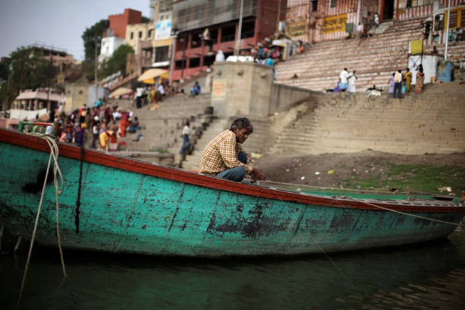 A man fishes at the banks of river Ganges in Varanasi.