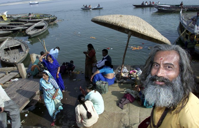 A Hindu holy man stands on the banks of the Ganges in Varanasi.