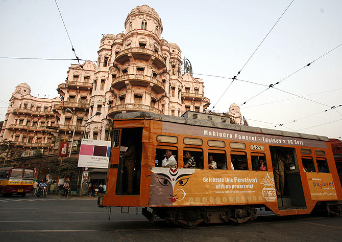 A tram passes beside a heritage building in the eastern Indian city of Kolkata.