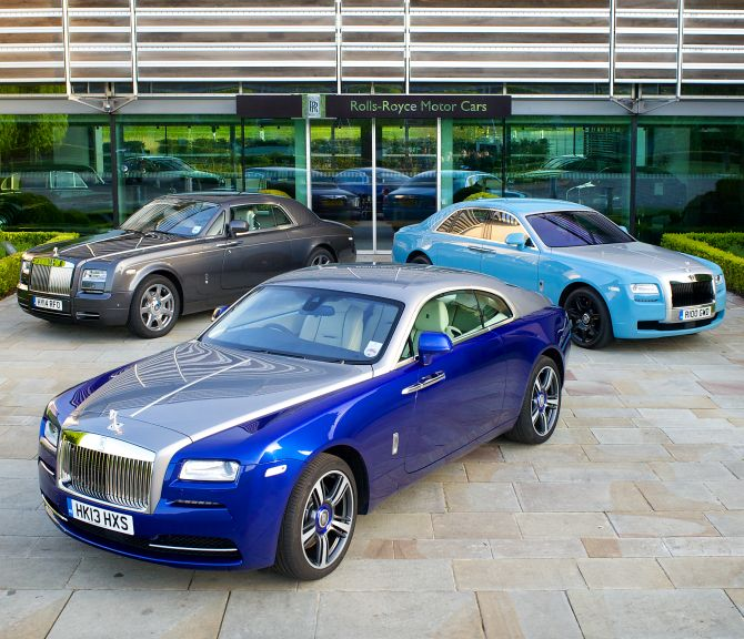 Rolls-Royce Phantom Coupe (left), Ghost (right) and Wraith (front).
