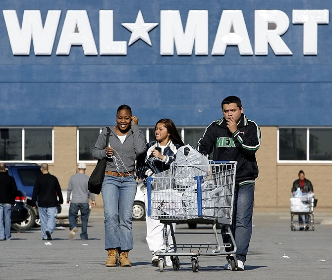 Shoppers leave a Wal-Mart store in Niles, Illinois.
