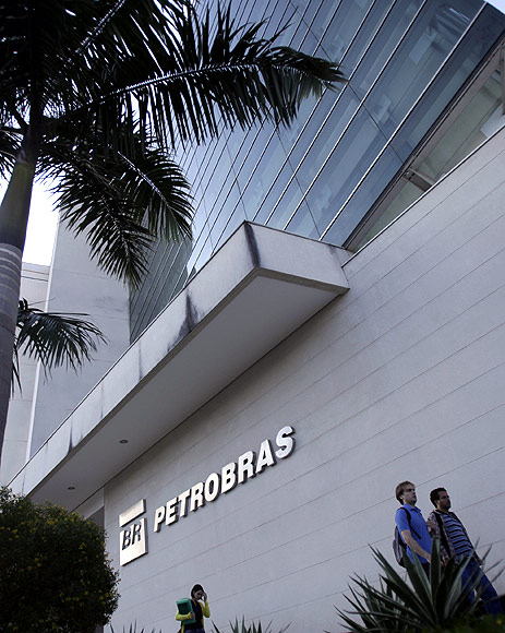 People walk in front of the Petrobras University building in Rio de Janeiro.