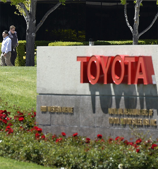 People walk at the national headquarters of Toyota Motor Sales USA.