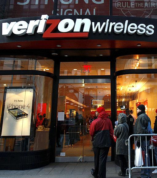 Customers wait in line outside a Verizon Wireless store in New York.