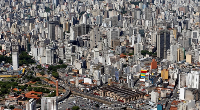 An aerial view shows downtown Sao Paulo, including Municipal Market.