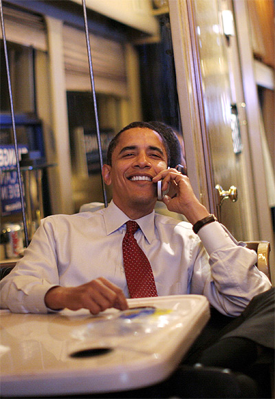 US President Barack Obama talks on the phone with his family during a campaign bus trip near Sioux City, Iowa.