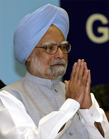 India's Prime Minister Manmohan Singh gestures during the national communal harmony awards ceremony in New Delhi.