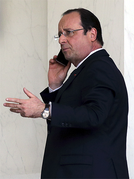 French President Francois Hollande speaks on his phone at the Elysee Palace in Paris.