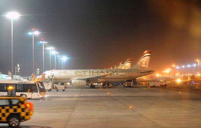 Etihad Airways aircraft are seen at Abu Dhabi International Airport.