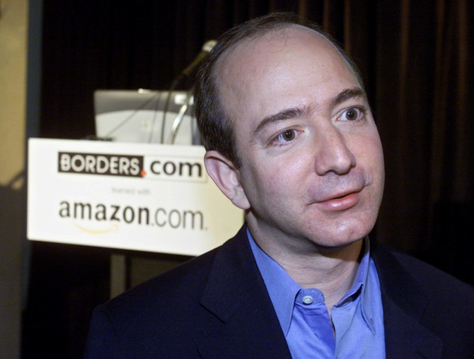 This file photo shows Amazon.com CEO Jeff Bezos talking with reporters at a press conference in New York.