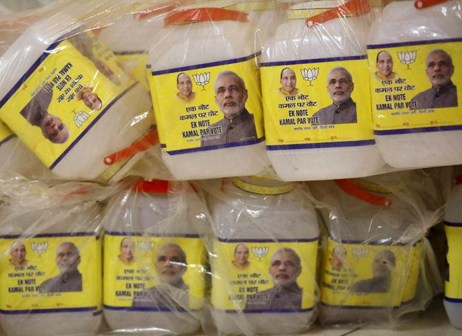 Plastic jars with images of Hindu nationalist Narendra Modi (R), the prime ministerial candidate for India's main opposition BJP, and party's president Rajnath Singh, are seen stacked atop of each other at the party's regional office in New Delhi.