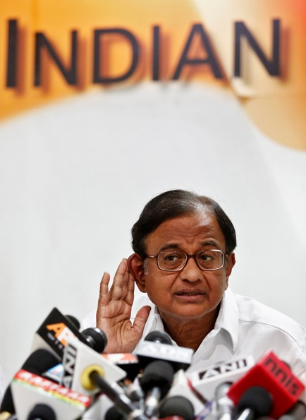 Finance Minister Palaniappan Chidambaram listens to a reporter's question during a press conference.