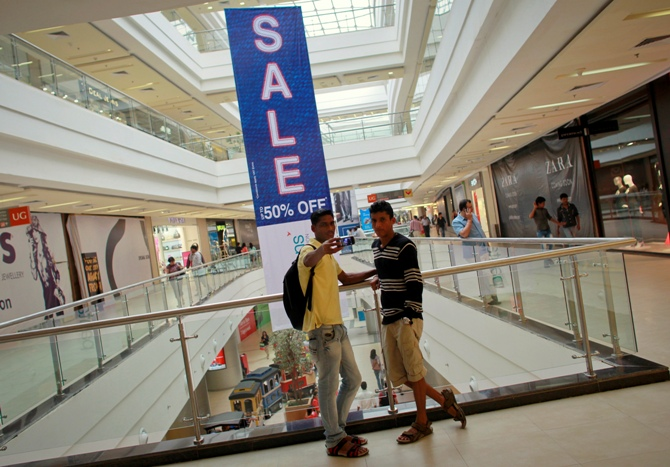 A shopper takes a photograph with his mobile phone inside a shopping mall in Mumbai.