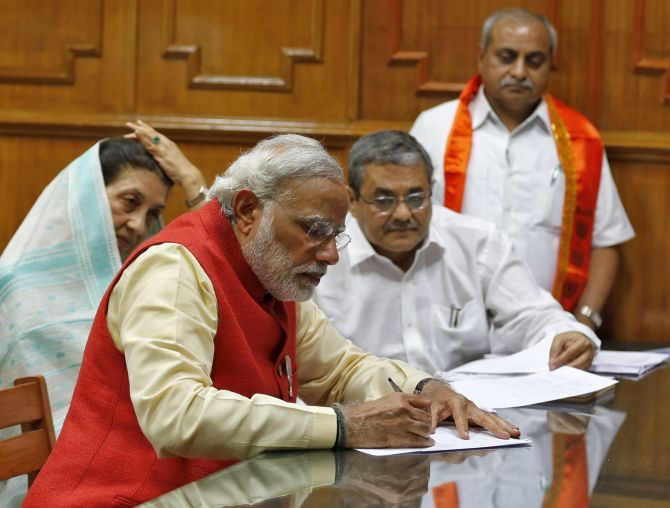 Hindu nationalist Narendra Modi, prime ministerial candidate for India's main opposition Bharatiya Janata Party (BJP), signs his nomination papers for the general elections in Vadodara.