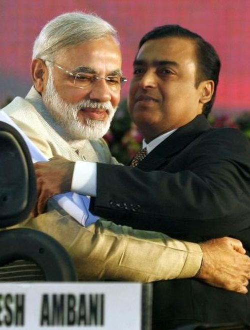 Indian Prime Minister Narendra Modi (L) embraces Mukesh Ambani, chairman of Reliance Industries, during the Vibrant Gujarat Global Investors' Summit 2011.