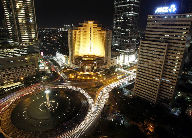The Welcome Statue fountain is seen before Earth Hour in Jakarta.