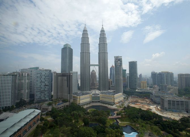 A view of Malaysia's landmark Petronas Twin Towers against an almost clear sky in Kuala Lumpur.