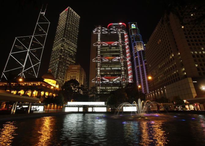Hong Kong's central financial district's (L-R) Bank of China Tower, Cheung Kong Centre, HSBC headquarters, Standard Chartered Bank and Legislative Council (front L) are pictured lighted up before Earth Hour.
