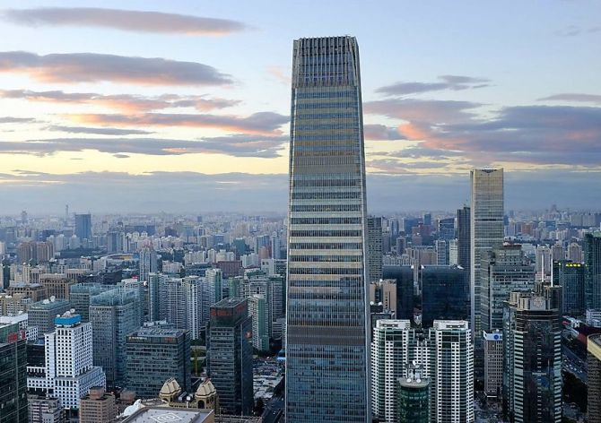 The China World Trade Center Tower III and other buildings are seen in Beijing's central business district August.