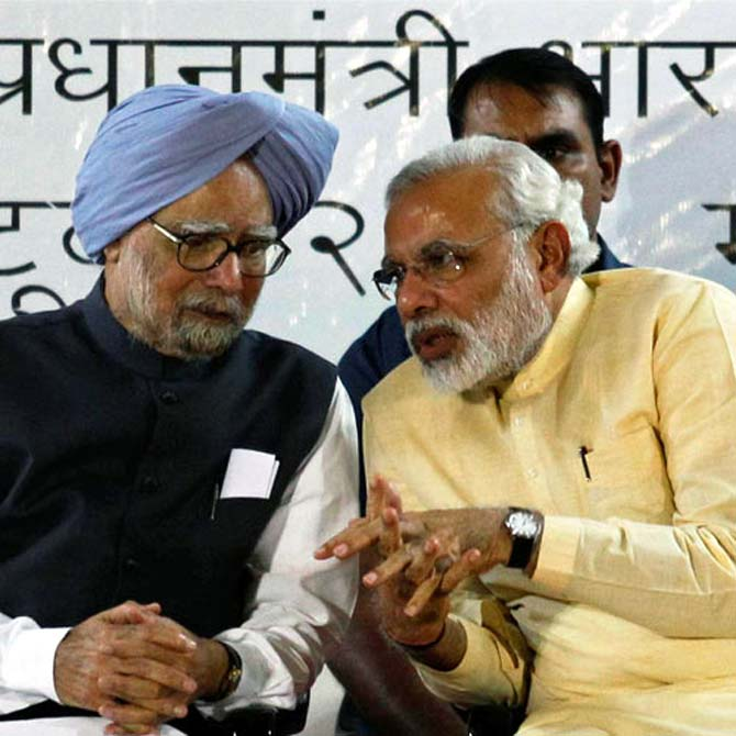 Prime Minister Manmohan Singh with PM designate Narendra Modi.