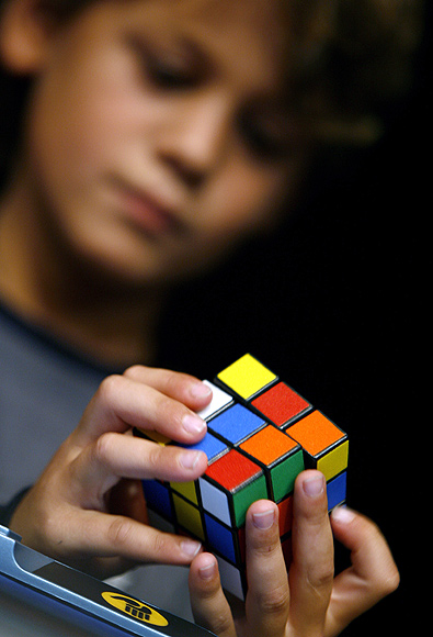A young competitor attends the World Rubik's Cube Championship in Budapest.