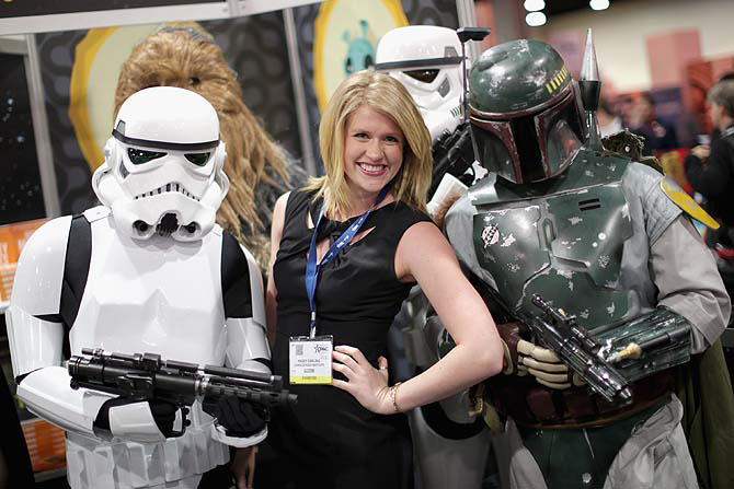 Kasey Darling of the Charles Koch Institute poses for photographs with people dressed as characters from Star Wars.
