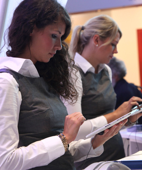 Women use an Apple iPad tablet computer during the Frankfurt Book Fair.