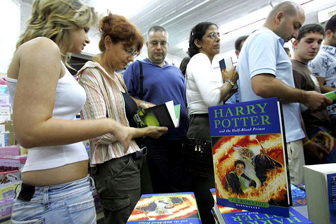 Israeli Harry Potter fans wait to pay for his copy of JK Rowling's new book.