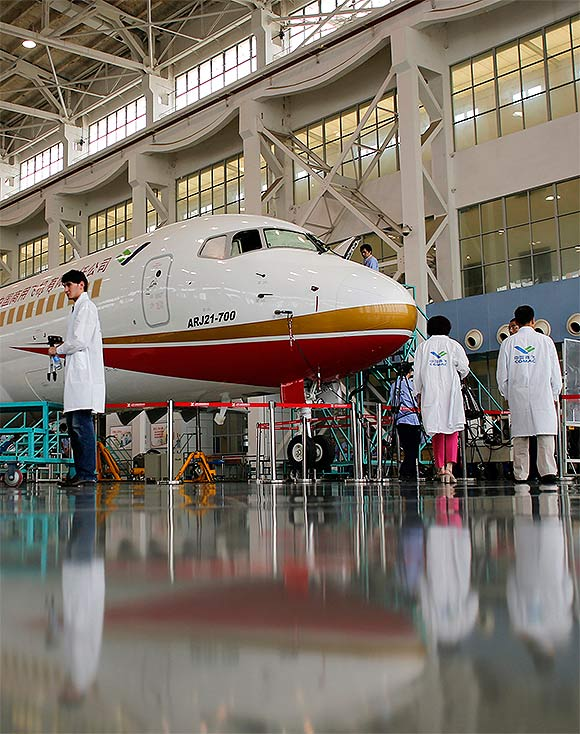Members of the media visit a ARJ21-700 aircraft model at the Commercial Aircraft Corp of China Ltd (Comac) factory in Shanghai.