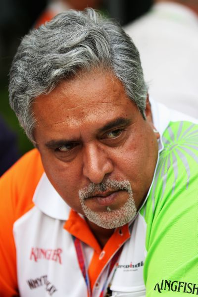Vijay Mallya is interviewed by the media following qualifying for the Indian Formula One Grand Prix at the Buddh International Circuit.