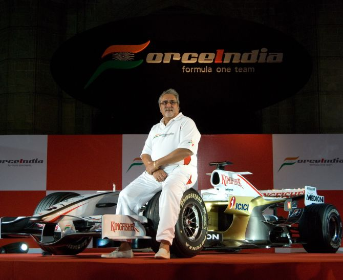 Chairman of Force India F1 team, Vijay Mallya, poses with the new Force India Formula One Team car on display at the launch held infront of the Gateway of India.