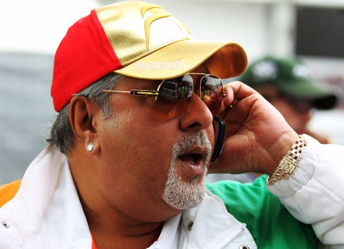 Vijay Mallya walks in the paddock during the Australian Formula One Grand Prix.