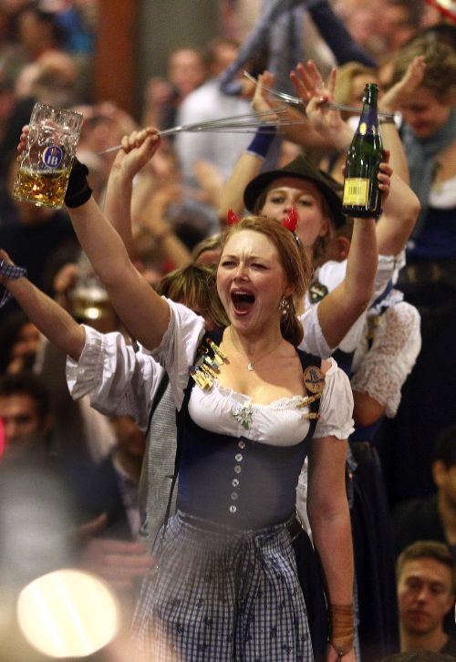 Oktoberfest waitresses dance on the tables while they celebrate the end of the world biggest beer festival.
